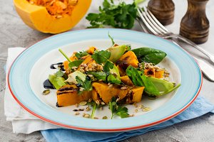 Roasted pumpkin salad with spinach, avocado, seeds and balsamic sauce