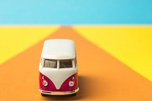 Vintage miniature bus in trendy color, travel concept