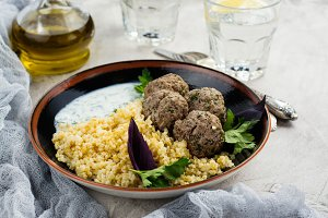 Homemade roasted beef meatballs and bulgur