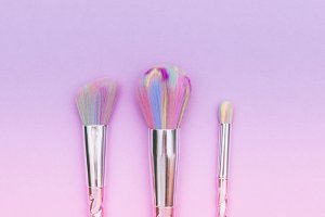 makeup brushes on gradient