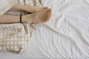 feet woman sleeping in bed