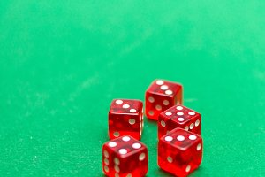 dice on a green background