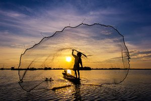 fishermen throwing net fishing
