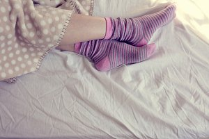 girl with wool socks, sleeping in be