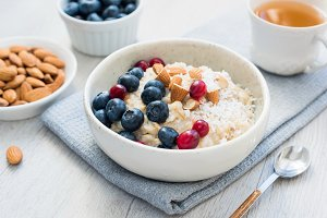 Oatmeal porridge bowl, healthy food