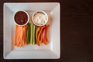 Fresh carrot cucumber pepper and two sauce