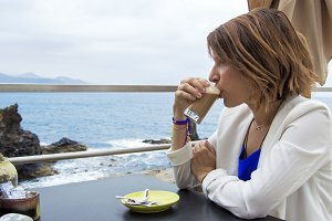 Woman having a coffee outdoors.