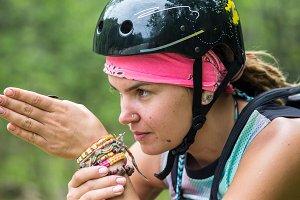 Bike helmet - woman putting biking