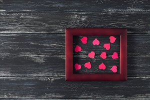 Pink hearts in a wooden frame