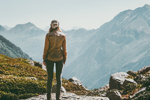 Woman alone standing in mountains