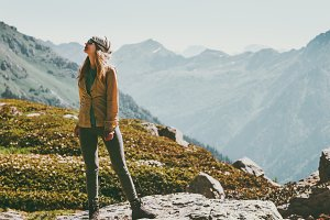 Woman walking enjoying mountains