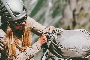 Woman climber with backpack