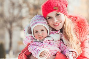 Portrait of mother and daughter in winter