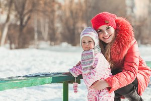 Mother and daughter enjoying winter