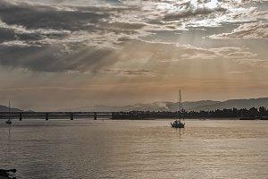 Boat sailing at dawn