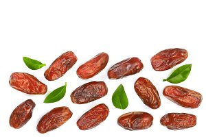 dry dates with green leaves isolated on white background with copy space for your text. Top view. Flat lay pattern