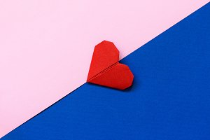 Origami heart. Red, pink and blue