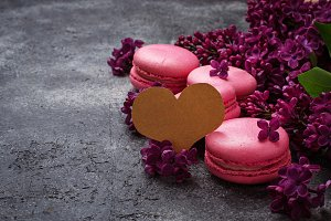 Festive background with  macaroons and lilac