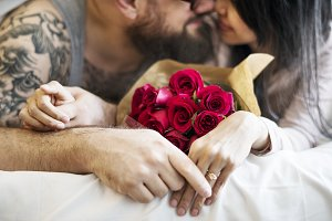 Husband surprised wife with red rose