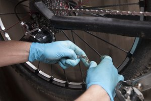 reparing the chain of a bicycle