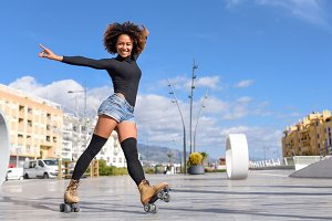 Black woman on roller skates outdoor