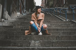 Female on old stairs