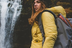 Hiker enjoys waterfall view