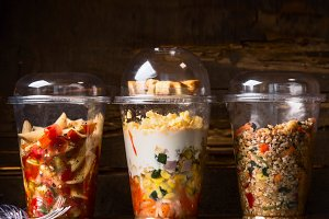 Lunch salads in plastic cups