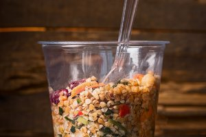 Healthy bulgur salad in plastic cup
