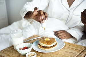 A person having breakfast in bed