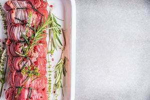 Raw roast beef with herbs
