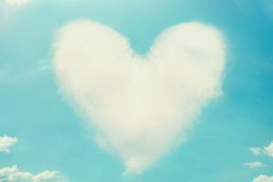 Clouds shaped heart at blue sky