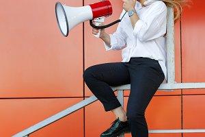 Girl activist holding a loudspeaker