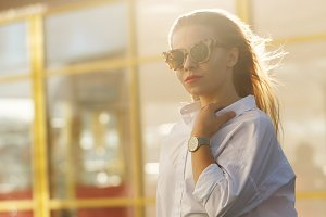 Girl in a shirt and sunglasses