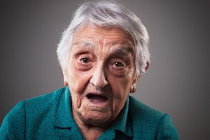 Elderly woman, surprised expression