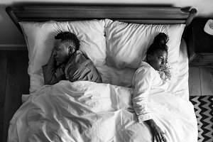African American couple sleeping