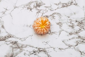 tangerine on a white marble