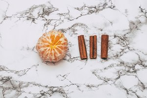 tangerine and cinnamon on marble