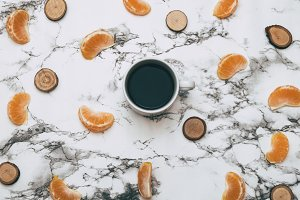 Coffee and tangerine slices