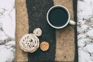 Coffee and wicker balls on scarf