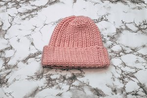 Pink beanie on marble
