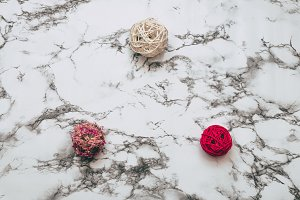 Wicker balls on marble