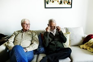 Senior friends sitting on the couch