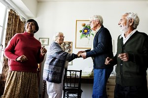 Senior friends dancing together