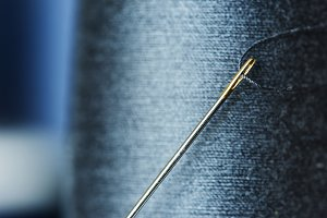 Sewing threads dark purple closeup