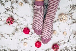 Woman pink socks on marble