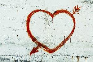 Red heart graffiti over grunge cemen