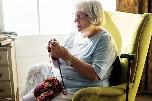 Senior woman knitting for hobby