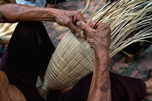 Old Vietnamese male craftsman hands