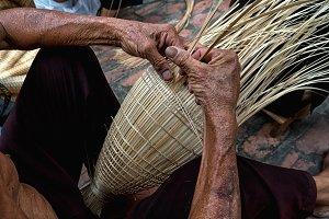 Old Vietnamese male craftsman hands